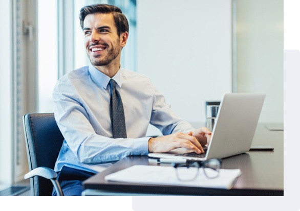 Man smiling while sitting at computer